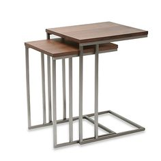 Create a space-saving modern look with the Tabella tables in this 2-piece set. The tables have uniquely designed legs that slide under chairs and sofas to conserve space but stay handy for when you need them.