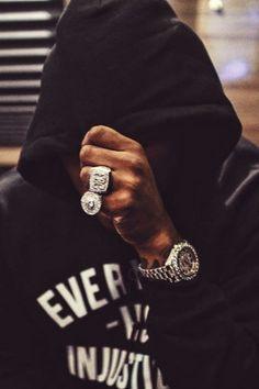 Future Hendrix wearing  Detroit vs. Everybody Everybody Vs. Injustice Hooded Sweatshirt, Rolex Datejust II 41MM Full Diamond