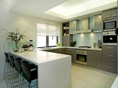 Photo of a modern u-shaped kitchen using stainless steel from the kitchen image galleries - Kitchen photo 1405094. Browse hundreds of images of modern kitchens & photos of u-shaped kitchen designs.