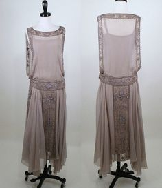 putty colored 1920's silk chiffon flapper dress. Heavily bronze beaded and taupe floral and deco embroidery trim, dropped waistband and panels are the focal point of dress followed by a lovely, fluttery handkerchief hem. Under slip is made of same silk chiffon with silk lining. Multi side snap closure at left side, including left strap for ease of entry.