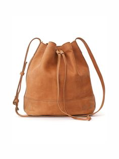 Handcrafted in Ethiopia, the Tadesse leather bucket bag features minimal detailing, a roomy interior, and soft, slouchy leather. The drawstring closure keeps your essentials secure, while allowing eas