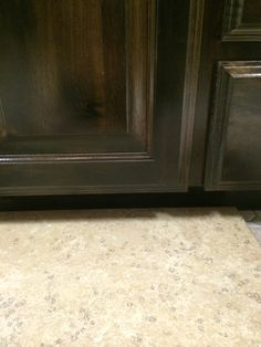Knotty Alder Cabinets stained in Ebony