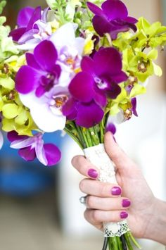 Beth's Bridal bouquet...purple, green, & white orchids hand tied, local fresh & Costa Rican