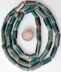 Matched Venetian green chevrons #5011     Diameter size: 5.5 to 9mm. Longest bead: 21 x 7mm     Date: Late 1800s to early 1900s - Price: $40.00