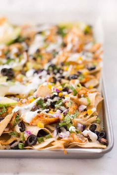 These easy and healthy Shredded Chicken Nachos are a super easy weeknight meal. They take less than 40 minutes from start to finish and use a sheet pan for eas Baked Boneless Chicken Recipes, Healthy Chicken Recipes, Mexican Food Recipes, Dip Recipes, Vegetable Recipes, Free Recipes, Vegetarian Recipes, Dinner Recipes, Shredded Chicken Nachos