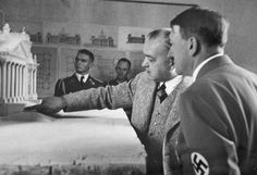Adolf Hitler looking at the layout. At the background is Max Wunsche
