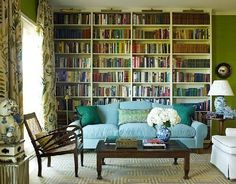 The soft blue sofa stands out against a dizzying backdrop of hundreds of books. Boldly patterned drapes and geometric rug offer old-world charm. My Living Room, Living Spaces, Turquoise Sofa, Long Room, Home Libraries, Custom Drapes, Interior Decorating, Interior Design, Decorating Ideas