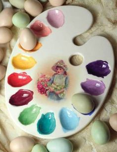 """Painter's Palette Egg Platter    Whether displaying hard boiled Easter eggs or the deviled variety, a whimsical porcelain dish celebrates nature's hues in clever form. Gift boxed. 14 x 10""""."""