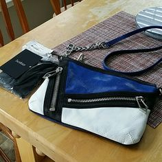 Gorgeous Botkier crossbody purse Ultraviolet  Cruz crossbody with beautiful silver tone hardware.  So so so so cute!!!!!!!.  Dust bag and the Authenticity card included.  Gorgeous!!  Must see!  Please enjoy :) Botkier  Bags Crossbody Bags
