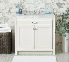 """Davis Single Sink Console from Pottery barn  l   33.25"""" w x 22"""" d x 37"""" h Sink console is constructed of poplar wood and MDF. Doors open to reveal open storage and a adjustable shelf. One faux drawer under sink. Includes zinc alloy hardware with a Polished Nickel finish. ($536.00 at Downeast Sandy)"""