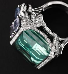 Cartier Boreal Ring - Platinum, one 29.00-carat aquamarine, three spinels totalling 5.37 carats, brilliants. Cartier 2012 #fk #fashionkiosk #jewelry #beauty #ring #shiny #ювелирное #украшение #кольцо #бриллианты