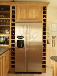 Built in wine rack along fridge...and FULLY stocked!