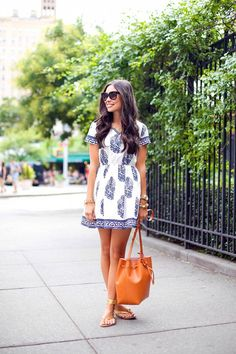 Blue & white printed dress and tan bucket bag. Cute and comfy!