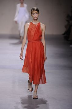 A micro-pleated bias-cut dress in flame technical organza
