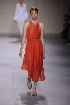 A micro-pleated bias-cut dress in flame technical organza