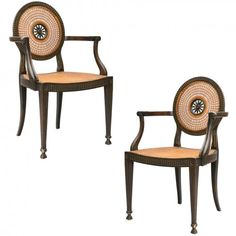 Pair of armchairs, with distressed ebonized finish; each having a round caned backrest centered by a pierced rosette, in a fluted frame; scrolling arms on downswept terminals frame a caned seat on fluted rail, raised on tapering square-section legs. Antique French Furniture, Vintage Furniture, Side Chairs, Dining Chairs, Antique Armchairs, Mid Century Armchair, Vintage Chairs, Furniture Collection, Modern Chairs