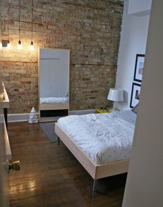 #brick/stone wall, pendant light bulbs, wooden floor