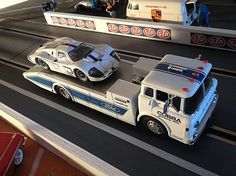 1/32nd scale Ford GT40 MkIV slot car on back of 1/32nd scale Ford COE hauler.