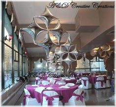 Beautiful hanging diamond shape balloons adorned this venue. We used Qualatex star point shapes to create this decor.