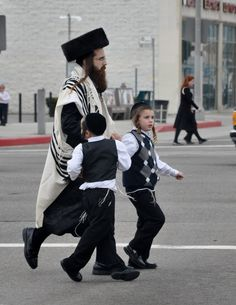 #Jewish father and sons off to pray     THEY LIVE IN Boro Park Brooklyn, N.Y.
