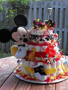 Mickey Mouse Diaper Cake - made with 65 baby diapers and many other goodies! when i need one a diaper cake lol by janis Idee Baby Shower, Baby Shower Diapers, Baby Shower Cakes, Baby Shower Themes, Baby Boy Shower, Baby Shower Decorations, Baby Shower Gifts, Shower Ideas, Mickey Mouse Baby Shower