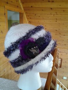 White wool with a touch of purple in the eyelash and splash of fabric to boost!