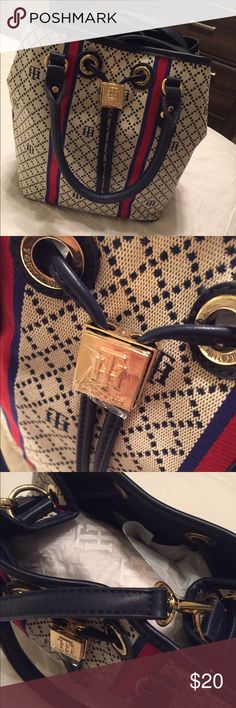Tommy Hilfiger Purse Navy, red and white purse with gold accents. Got as a gift but not my style, never used still has packaging on inside. Has short and long handles- would look cute with jeans! Tommy Hilfiger Bags Shoulder Bags