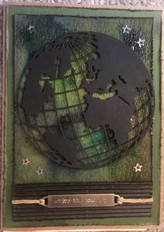 Graduation card using Tim Holtz globe thin lit die and Ken  Oliver's colorburst.