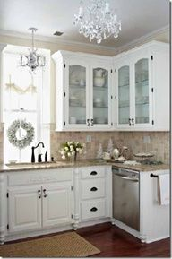everything about this kitchen I love...darker floor, perfect counter tops, white glass front cabinet with dark hardware, stainless steel appliances, wall color, chandeliers, I would use bead board back splash,