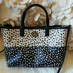 Tory Burch Pony Print Tote Black and off white tote, great contrast.  This is the cutest Tory I've had. Has removable clutch that is crazy insane. It's really 2 bags in one!! Pre-owned great condition. Tory Burch Bags Totes