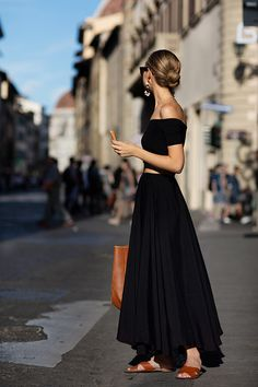 black off the shoulder top, maxi skirt, tan leather sandals and bag