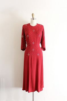 Red crepe evening dress with silver studs throughout c. 1940s