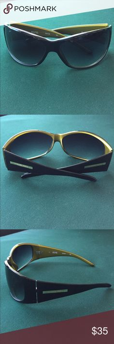 Michael Kors wraparound sunglasses Edgy and sexy Michael Kors wraparound sunglasses with glossy black outer plastic frames and gold tone inner frames.  Gold tone logos on both temples.  Smoke gradient lenses.  Pretty good condition with very minor signs of wear.  I take very good care of my collections and our home is pet-free and smoke-free.  We're getting ready for a major move so am slowly -- and painfully -- divesting :-)  No case but will pack very well to protect from scratches.  Thank…
