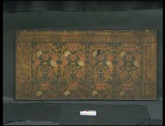 Embossed gilt leather altar frontal consisting of four panels and eight borders on either side and the top. Below the four panels a row of the top-halves of four other panels. The pattern of the panels consists of diamond-shaped compartments, filled by vases and flowers in various colors on a gilded ground. The borders at the two sides are ornamented with stems entwined by flowers, and the top-border has a fringe of gilded tassels on a red ground. ca 1680-1730   V%A Museum, London