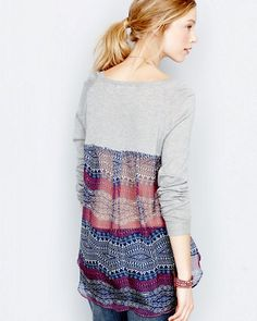 We love the juxtaposition of knit and silk, especially when the mix is as artful as this easygoing sweater. In the front, the vintage-inspired silk dips beneath the bottom for a double-layered effect; in the back, there's a wide slice of peekaboo pattern for a pretty rear view (it's very sheer).