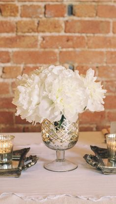 Mercury silver vases with beautiful white peonies for wedding centrepieces