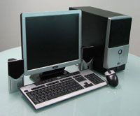 Desktop computer, monitor, keyboard, speakers and mouse.