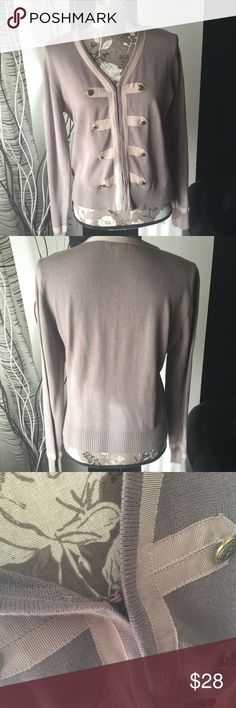 CAbi tan top Sz m Pre owned CAbi tan top Sz m in excellent condition. No rips tears or odor. Please refer to pics for true detail description of the condition and please message me if you have any questions thank you and happy shopping! CAbi Other