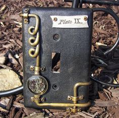 Reserved for Nicole Steampunk Steam Punk Light Switch Plate Switchplate Cover Polymer Clay. $25.00, via Etsy.