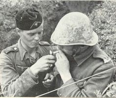 Romanian soldier has a cigarette lit by his German comrade. History Of Romania, Central And Eastern Europe, Military Diorama, German Army, War Machine, Armed Forces, World War Two, Troops, Wwii