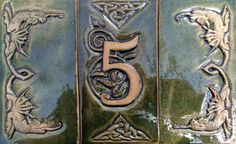 Celtic ceramic house number with dragons by CelticValleyCeramics