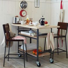 steel rolling cart with butcher block top. Use as kitchen island and with bar stools.