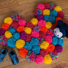 Add a Pop of Color to Your Kid& Room With a Hidden Mickey Pom Pom Rug Popsicle Stick Crafts, Craft Stick Crafts, Crafts For Kids, Disney Diy, Disney Crafts, Disney Stuff, Diy Using Yarn, Pom Pom Rug, Pom Poms