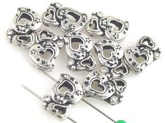 *Cast in pewter silver with clear rhinestones with beautiful heart shape design. Each bead has a beautiful texture throughout. These beads are lead compliant and nickel compliant. Measurements for the