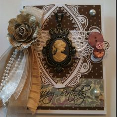 Hand made birthday card using a cameo necklace as the center piece.
