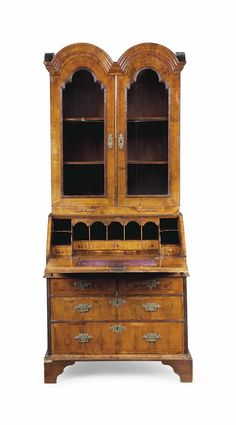 A QUEEN ANNE WALNUT BUREAU CABINET -  RETAILED BY EDWARDS & ROBERTS, EARLY 18TH CENTURY AND LATER