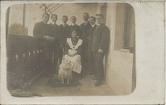 POMERANIAN SPITZ WITH WOMAN & GROUP OF MEN REAL PHOTOGRAPHIC DOG POSTCARD
