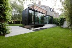 Restauration and extention of the House VH by Caan Architecten. Nice concrete stepping stones.