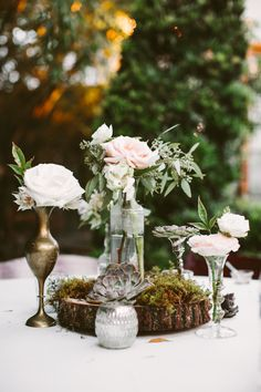 Succulent and rose garden centerpieces: http://www.stylemepretty.com/louisiana-weddings/new-orleans/2015/11/05/romantic-southern-wedding-at-race-religious/   Photography: Glass Jar - http://glassjarphotography.com/index2.php#!/HOME