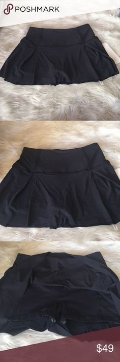 Lululemon Lost in Space 8R Brand new Lululemon Lost in Space Size 8R Midnight. This  breezy skirt with stretchy, built-in shorts so you can give it your all from the trails to the tennis court. Slip your phone into the drop-in pocket in the liner, and thread your headphones through the cord exit to minimize cord bounce. Fabric is sweat-wicking and four-way stretch lululemon athletica Skirts